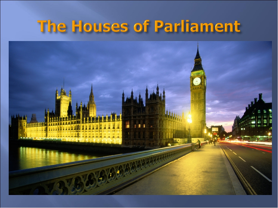 They are long grey buildings with towers. The large clock in one of the tower...