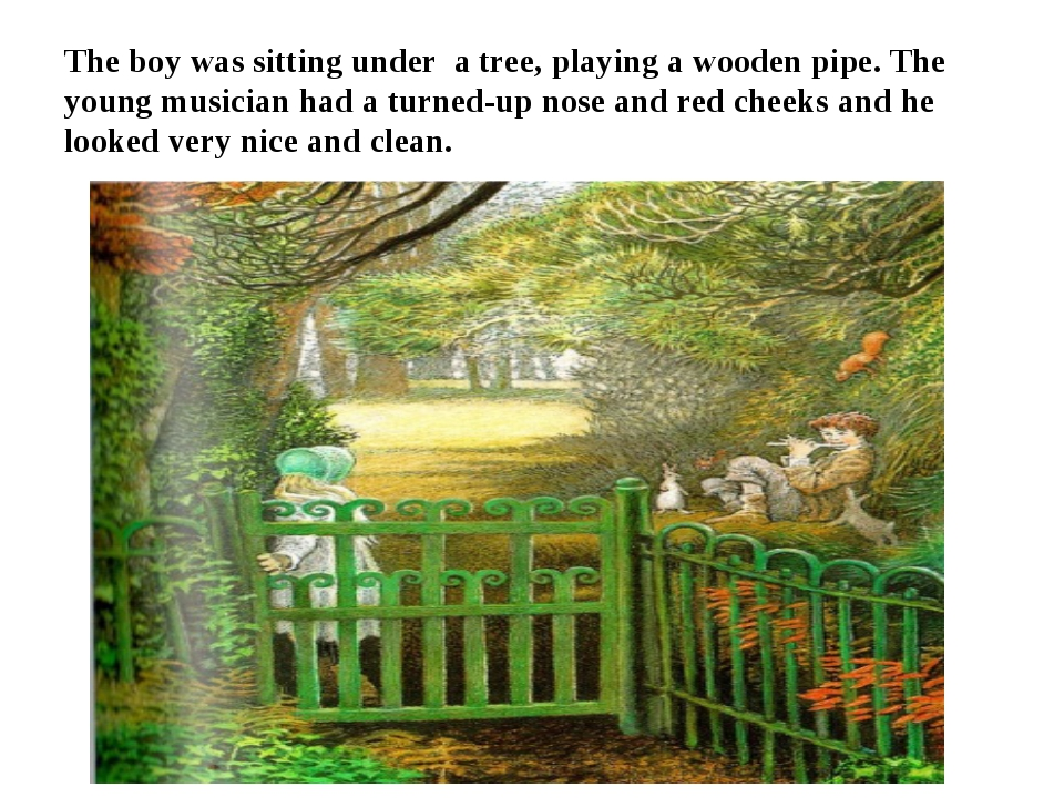 The boy was sitting under a tree, playing a wooden pipe. The young musician h...
