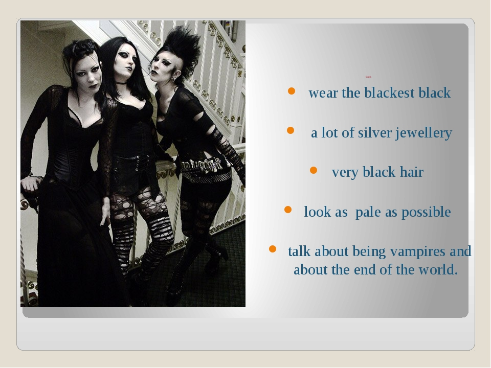 Goth wear the blackest black a lot of silver jewellery very black hair look...
